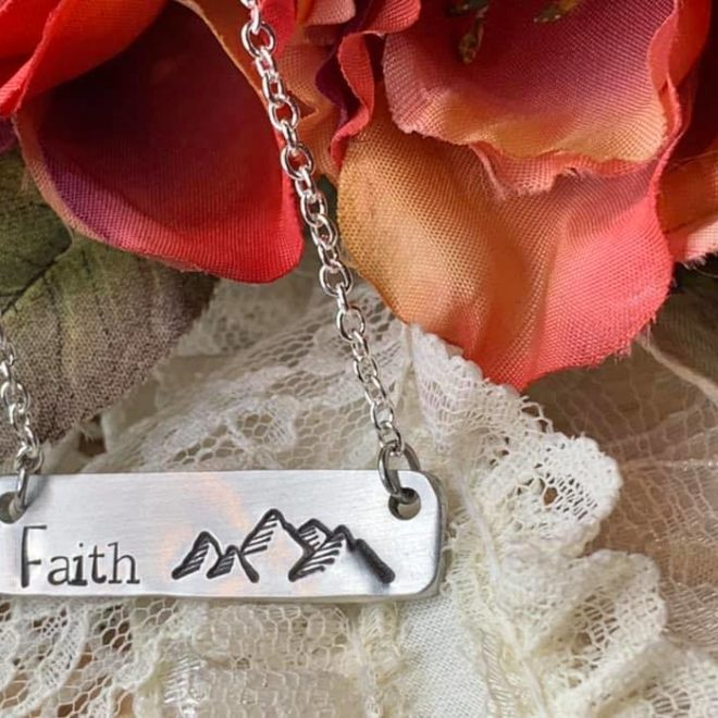 Handstamped necklace with mountains and the word Faith